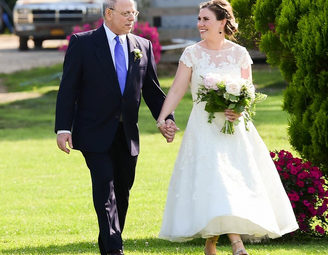 Leslie Ross with her father on her wedding day