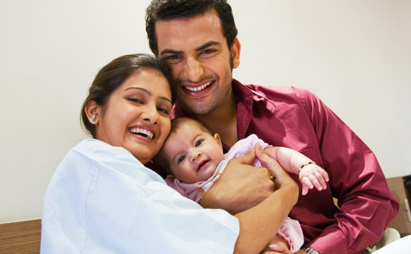 Couple with their child