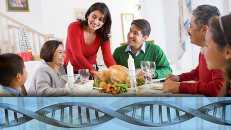 a multigenerational family eating a Thanksgiving meal with DNA