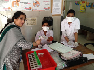 Dr. Sujata Baveja and TB nurses provide patient information at the TB clinic of LTM Hospital in Mumbai, India. (Photo Credit: Susan Maloney, CDC)
