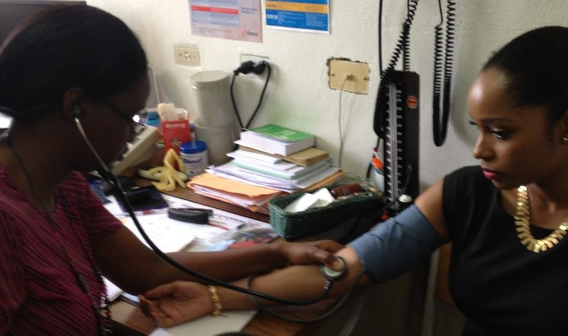 Patient at the Edgar Cochrane Polyclinic in Barbados having her blood pressure taken.