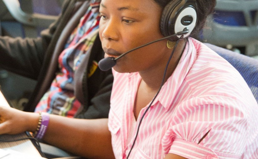 Mabinty Tarawally answers calls at the 117 Call Center in Freetown Sierra Leone.