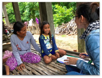 A nine-year old girl and her grandmother being interviewed in Svay Rieng province about her knowledge on HPV vaccine