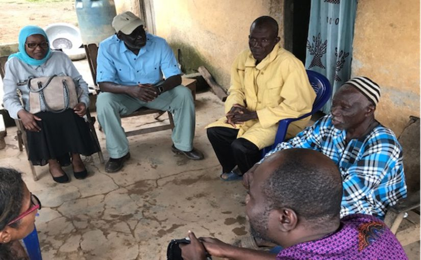 Serigne Ndiaye, CDC GHSA Program Director for Cote d'Ivoire, center, meets with community leaders