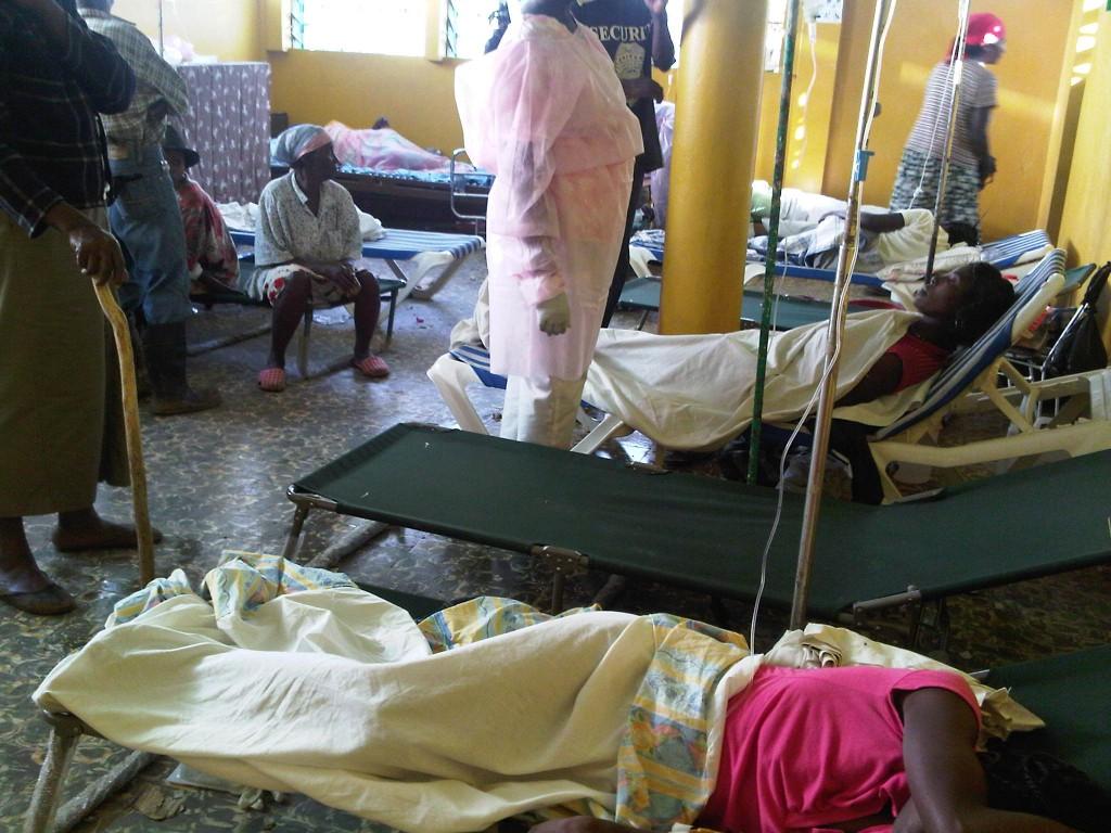 Haitians receiving treatment for cholera.