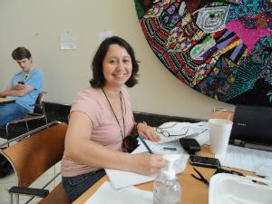 Araceli working in the dining area of the Haiti U.S. Embassy