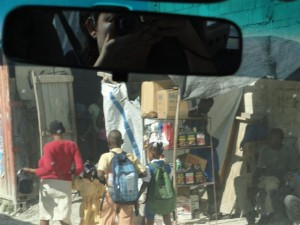Araceli taking pictures of the streets of Haiti from her car