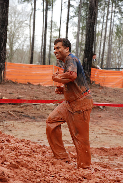 Dr. Ali Khan running through mud