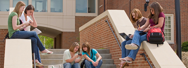 College students sitting on steps