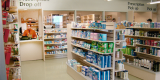 Picture of a pharmacy counter taken from one of the aisles