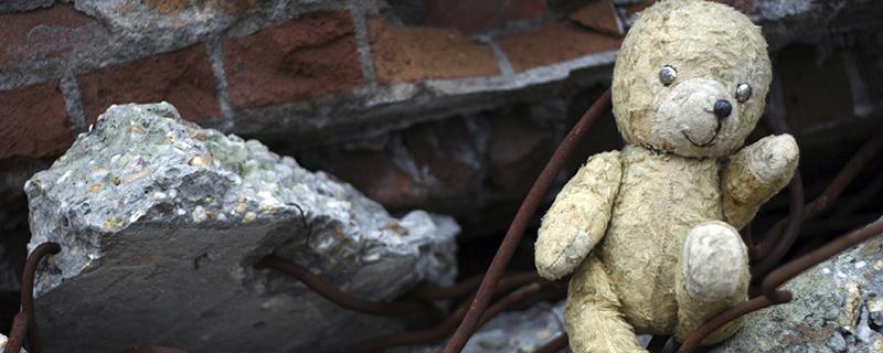 Teddy bear in rubble