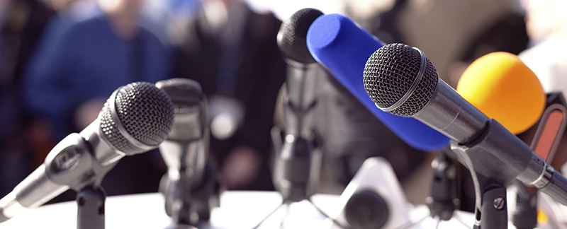 microphones set up for a news conference