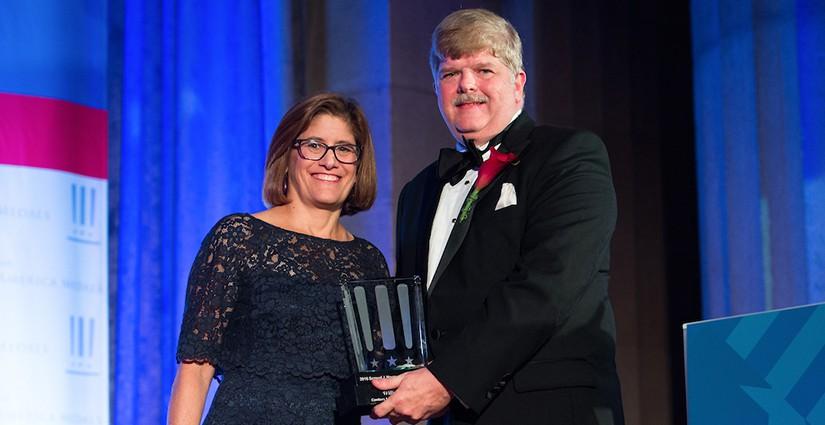 Greg Burel receiving SAMMIE award.