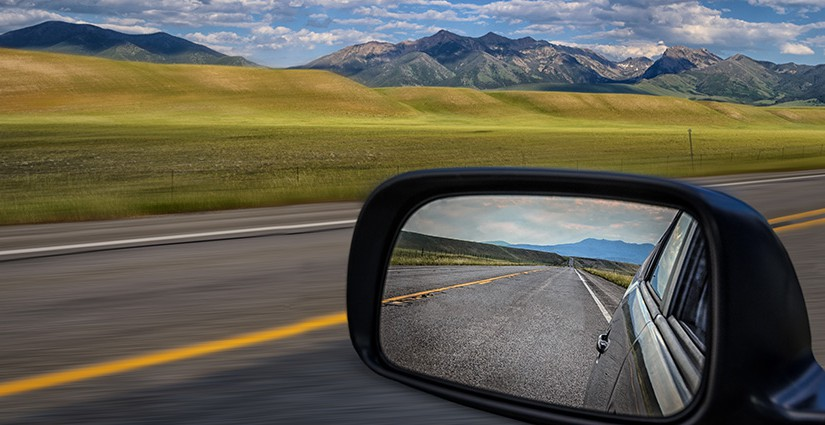 Looking through the rearview mirror while driving in the planes
