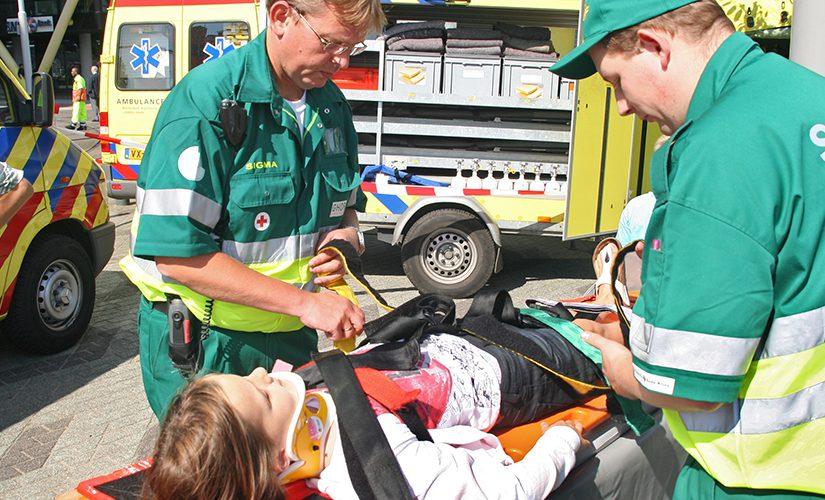 """ROTTERDAM, HOLLAND - SEPTEMBER 5, 2010: Demonstration of handling of car crash victim by medics at the annual World Harbor Days in Rotterdam, Holland on September 5"""