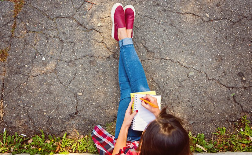 student studying outdoors.