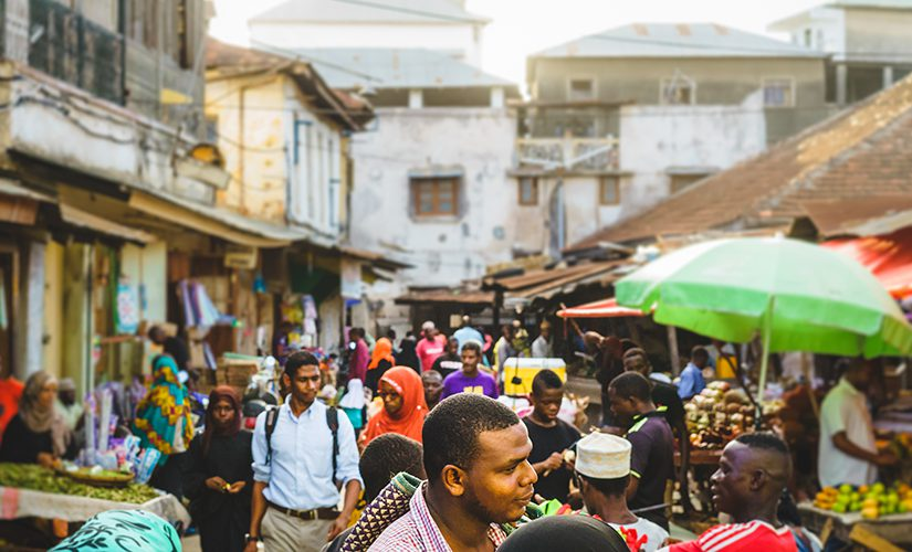 People walking a busy street in Zanzibar.