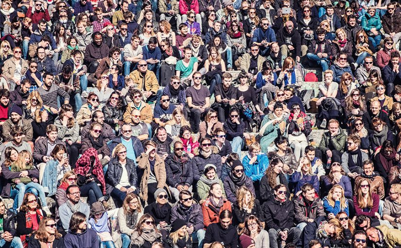 A crowd of people at Mauerpark in Berlin, Germany.