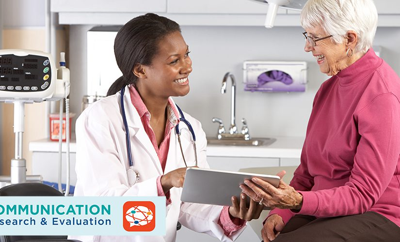 A female doctor discussing records with a senior female patient.