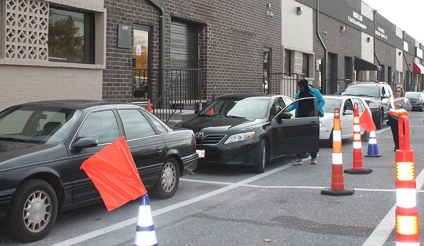 A line of vehicles at a point of dispensing drill