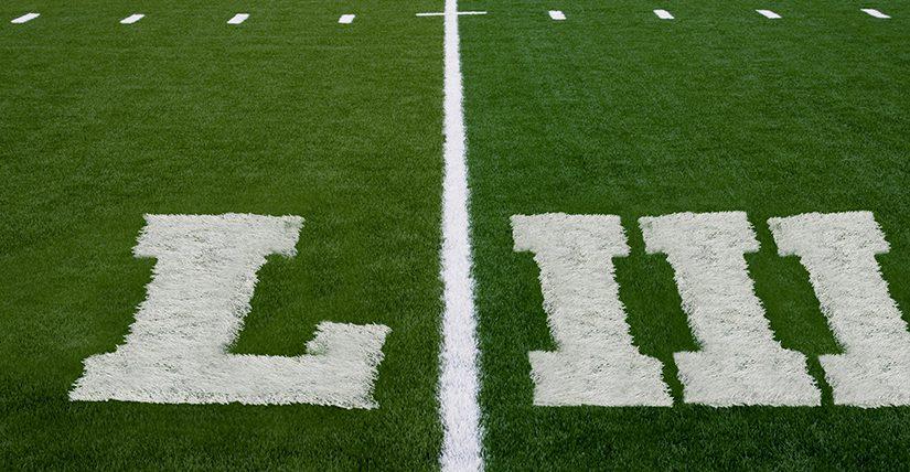Roman numerals LII written on a football field