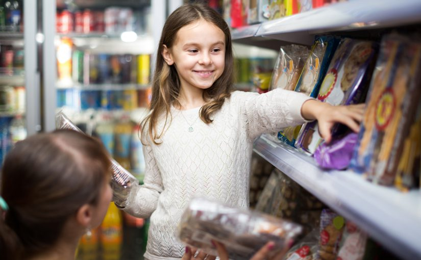 Woman and young girl grocery shopping