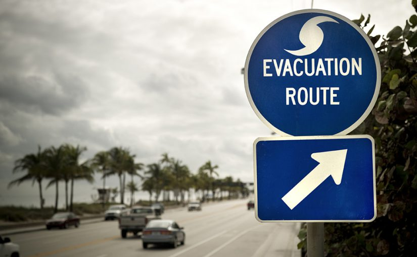 Road sign pointing in the direction of a hurricane evacuation route.