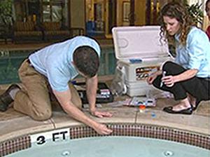Investigators sample a hot tub