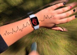 an arm with a smart watch and a heartbeat drawn on the arm