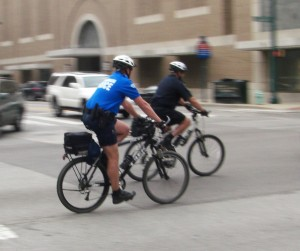 two bicycle-mounted police officers