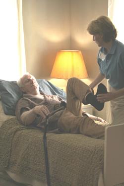 nurse bends man's leg