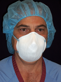 surgical personnel wearing an N95 respirator