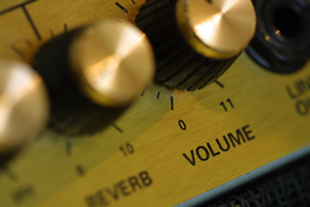 Knobs on an amplifier, including a volume dial marked '11'