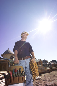 worker with glaring sun to his back