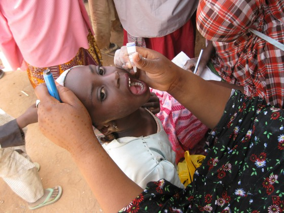 Photo of a child receiving the oral polio vaccine