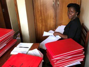 FETP Resident Pheobe Hilda Alitubeera searching for tetanus cases in health facility registers.