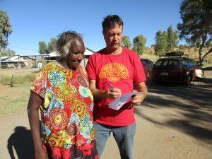 Jon Veverbrants surveys a community member in Central Australia.