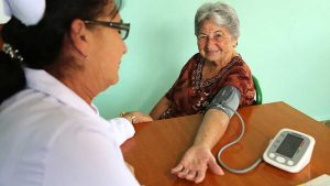 A nurse measures a woman's blood pressure at a clinic in Matanzas, Cuba, one of the HEARTS sites.