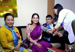 Minister of State for Health and Population, Padma Kumari Aryal, receives blood pressure screening at 2018 May Measurement Month inauguration. Photo credit: Kamal Ranabhat