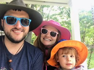 Ginny and her family with hats and sunglasses.