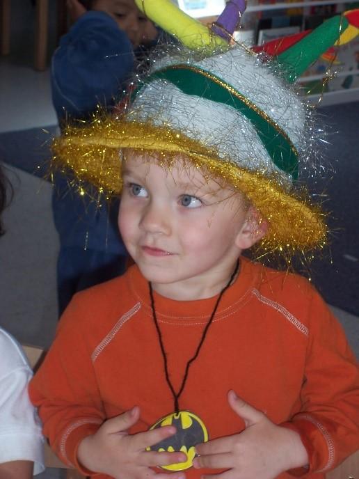 Mason wearing a decorative hat