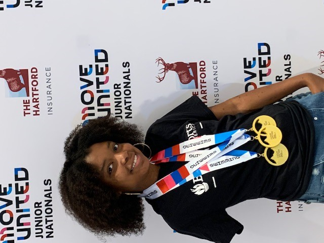 Tyler with swim medals around her neck