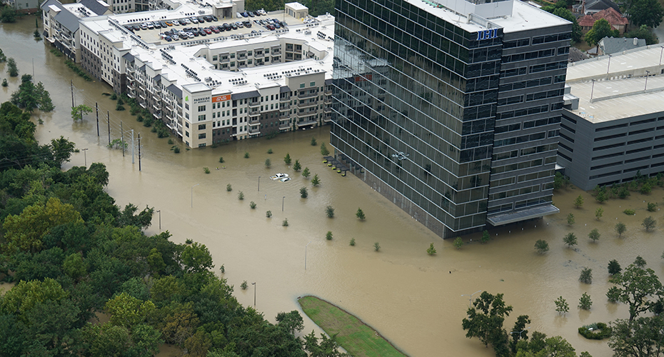 Photo of a flooded apartment complex and office building during Hurricane Harvey.