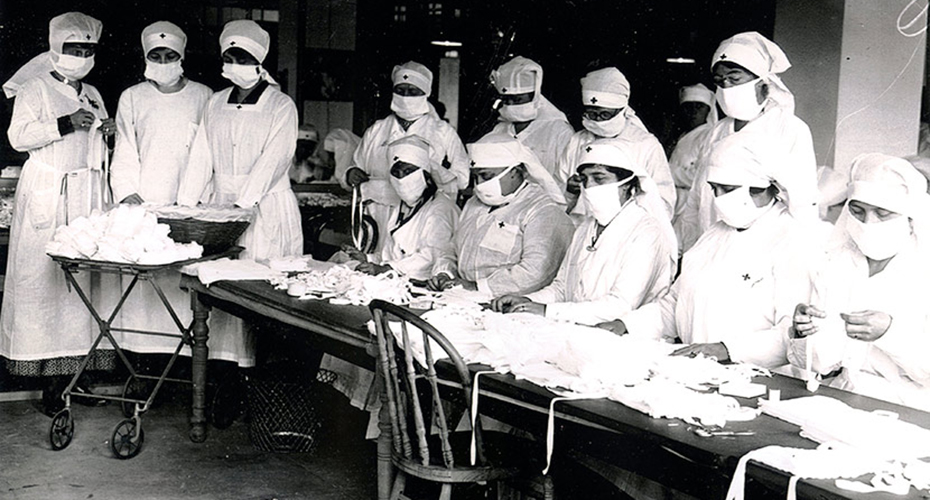 Group photo of Red Cross nurses in Boston wearing personal protective equipment.