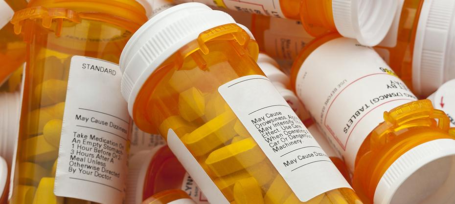 A pile of prescription medicine bottles.