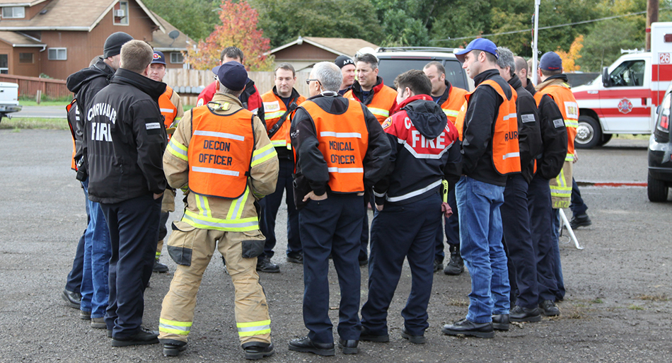 Emergency responders gathered in a circle.