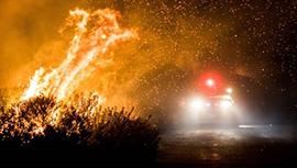 A fire truck responds to a brush fire.