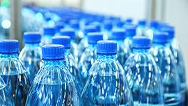 Bottles of water on a conveyor belt.