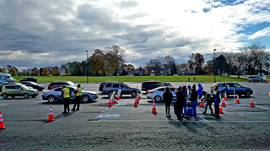 Vehicles line up to participate in a drive-thru flu clinic in Bethlehem, Pa.