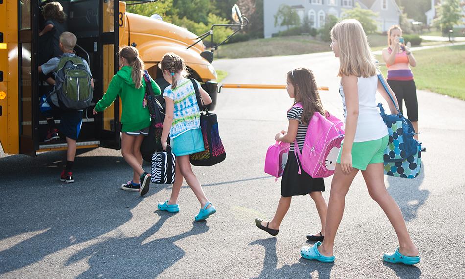 Children boarding a school bus.